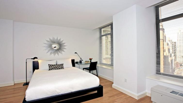Comfortable bed at Hanover Square Apartments